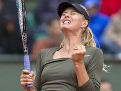 Maria Sharapova of Russia gets pumped up during her three-set victory Monday against Klara Zakopalova of the Czech Republic that moves her to the French Open quarterfinals.
