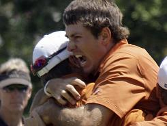Dylan Frittelli celebrates moments after sinking the winning putt on the final hole of his college career to give Texas its first men's golf title in 40 years.