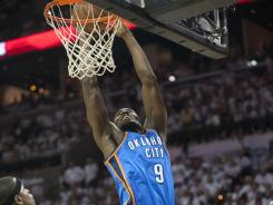 Thunder forward Serge Ibaka dunks during the first half of Oklahoma City's 108-103 Game 5 win against the Spurs in the Western Conference finals.