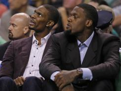 Chris Bosh, left, could return to the Miami Heat lineup Tuesday night vs. the Boston Celtics.