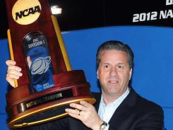 Kentucky coach John Calipari, hoisting the national championship trophy during an April appearance in Paducah, Ky., is coaching the Dominican Republic national team again this summer.