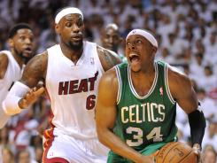 Celtics forward Paul Pierce drives past Heat forward LeBron James in Game 5 of the Eastern Conference finals. Boston won 94-90.