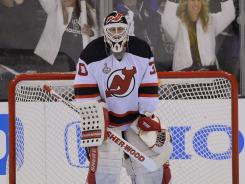 Martin Brodeur has a 2.09 goals-against average. The opposing goalie, Jonathan Quick, has a GAA of 1.36.