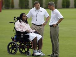Eric LeGrand talks with head coach Greg Schiano, center, and GM Mark Dominik, right, at Buccaneers OTAs on Tuesday.