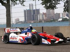 With downtown Detroit in the background, A.J. Foyt Racing's Mike Conway drives during Sunday's Belle Isle Grand Prix.