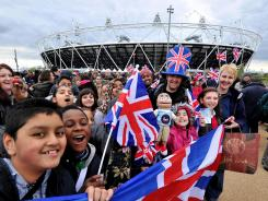 Spectators gather in May outside Olympic Stadium in London.