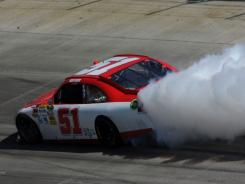 Kurt Busch's No. 51 Chevrolet blows an engine during Sunday's Sprint Cup race at Dover International Speedway. Team owner James Finch said Busch has ruined 14 cars this season.