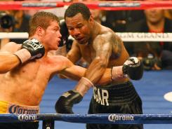 Shane Mosley, right, exchanging blows with Canelo Alvarez during their May 5 fight at the MGM Grand Garden Arena.