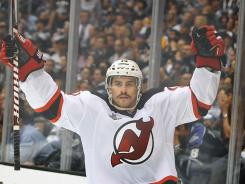 New Jersey Devils center Adam Henrique reacts after scoring a goal past Los Angeles Kings goalie Jonathan Quick during the third period of Game 4 on Wednesday at Los Angeles.