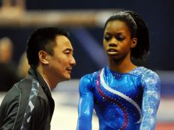 Gabrielle Douglas (right) talks to her coach, Liang Chow, during the Secret U.S. Classic in Chicago on May 26.