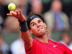Rafael Nadal of Spain advanced to the French Open men's semifinals with a 7-6 (7-4), 6-2, 6-3 victory against of Spain.