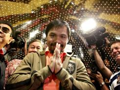 Manny Pacquiao, who fights Timothy Bradley on Saturday, got the crowd going upon his arrival at the MGM Grand on Tuesday.