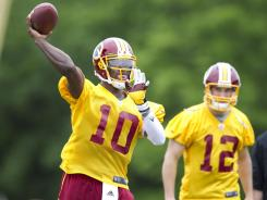 Washington Redskins quarterback Robert Griffin III (10) may be sweating training camp out in Richmond starting in 2013.