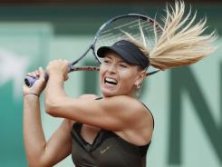 Maria Sharapova of Russia cruises into the French Open semifinals, rolling past Kaia Kanepi of Estonia 6-2, 6-3.