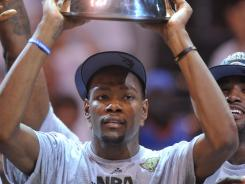 Oklahoma City forward Kevin Durant hoists the Western Conference championship trophy after the Thunder defeating the San Antonio Spurs 107-99 in Game 6.