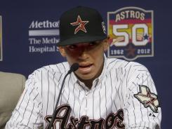 Carlos Correa is introduced during a news conference Thursday. Scouts think Correa could turn into a home run threat as he matures.