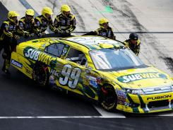 Crew members push Carl Edwards' No. 99 Ford to the garage Sunday at Dover International Speedway. Upcoming tracks could make or break Edwards' chances to make NASCAR's Chase title run.