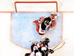 New Jersey Devils goalie Martin Brodeur makes a save on Los Angeles Kings left wing Dustin Penner.