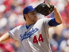 Dodgers' Aaron Harang won his 100th career game, becoming the 35th active pitcher to accomplish the feat.