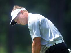 Bill Glasson putts on 18 Thursday in Round 1 of the Regions Tradition.