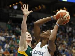 Minnesota Lynx forward Taj McWilliams-Franklin (8) looks up to the basket against Seattle Storm guard Katie Smith in the first half of a Lynx win on Wednesday.