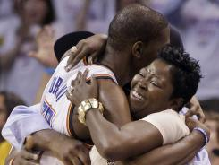 Oklahoma City forward Kevin Durant hugs his mother, Wanda Pratt, during the final moments of the Thunder's Game 6 win against the San Antonio Spurs in Game 6 on Wednesday.