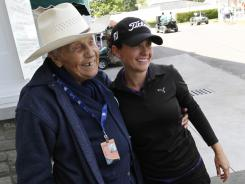 Rookie Mo Martin gets a hug from her 100 year-old grandfather, Lincoln Martin, after she shot a 1-under 71 in Round 1 of the Wegmans LPGA Championship.