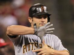 The Pittsburgh Pirates' Michael McKenry signals to the dugout after hitting a double to drive in a run in the 10th inning Thursday against the Reds. He picked a good time to hit his third double this season.