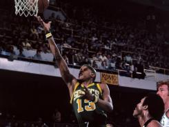 Slick Watts, No. 13, of the then-Seattle SuperSonics in 1976, still lives in the Seattle area and is helping to lobby the NBA for a team to replace the relocated Oklahoma City Thunder.
