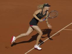 Maria Sharapova of Russia moves forward during her semifinal victory against Petra Kvitova of the Czech Republic, and now she moves into the final.