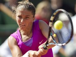 Sara Errani of Italy, above, will face Maria Sharapova of Russia in her first Grand Slam final.