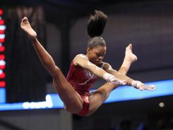 Gabby Douglas turned in four solid routines to tie for the all-around lead after the first day of the U.S. championships.