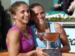 Sara Errani and Roberta Vinci of Italy show off their trophy after defeating Maria Kirilenko and Nadia Petrova of Russia to win the French Open women's doubles title.
