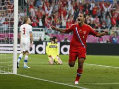 Russia's Roman Shirokov celebrates after he scored on Czech goalkeeper Petr Cech during the Euro 2012 soccer championship Group A match.