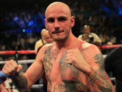Kelly Pavlik, shown here in a fight in 2011, had a seventh-round TKO victory against overmatched opponent Scott Sigmon Friday night in a 10-round super middleweight bout at the Hard Rock Hotel and Casino.
