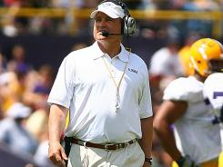 LSU approved a pay raises for Les Miles and his assistants worth more than $1 million.