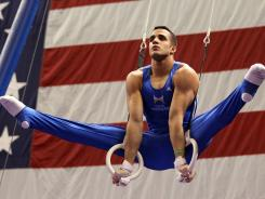 Danell Leyva competes on the still rings during day one of the U.S. men's gymnastics championships.