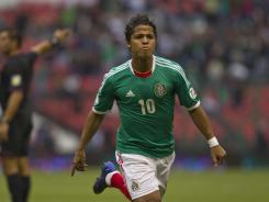 Mexico's Giovani Dos Santos celebrates a goal against Guyana during their World Cup qualifying soccer match in Mexico City.