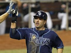 Matt Joyce homered, doubled and scored three times to help the Rays top the Marlins.