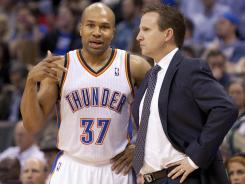 Oklahoma City Thunder point guard Derek Fisher speaks to Oklahoma City Thunder head coach Scott Brooks during the second quarter against Los Angeles Clippers.