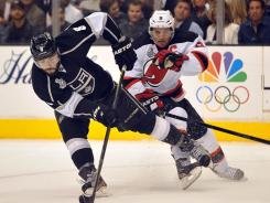 Kings defenseman Drew Doughty, left, and Devils left wing Zach Parise will continue their battle in Game 5 of the Stanley Cup Final, Saturday night in Newark.