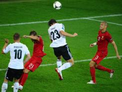 Mario Gomez of Germany scores the only goal of the Group B match against Portugal during the UEFA Euro 2012 tournament.