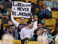 Seemingly all the pressure in the world lands on LeBron James' shoulders today as the Miami Heat try to beat the Boston Celtics in Game 7 and advance to the NBA Finals for the second season in a row.