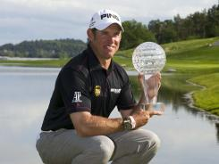 Lee Westwood poses with the championship trophy after winning the Nordea Masters at the Bro Hof Slott Golf Club in Stockholm.