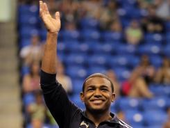 John Orozco waves to the crowd after winning the all-around title at the 2012 Visa Championships in St. Louis.