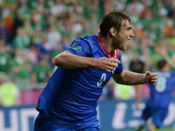 Croatian forward Nikica Jelavic celebrates after scoring during Sunday's match vs. Ireland.