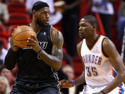 Miami's LeBron James is guarded by Oklahoma City Thunder's Kevin Durant.