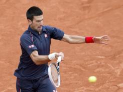 The rain-delayed men's French Open final, where Novak Djokovic is trying to rally from behind against Rafael Nadal, will continue Monday.