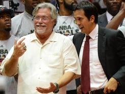 Miami Heat head coach Erik Spoelstra, right, and owner Micky Arison, left, celebrate after defeating the Boston Celtics.