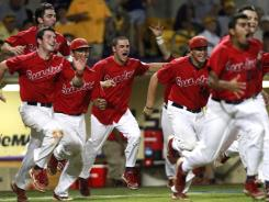 Stony Brook celebrates after defeating LSU 7-2 in Game 3 of an NCAA Super Regional game in Baton Rouge, La. The Seawolves advanced to the College World Series.